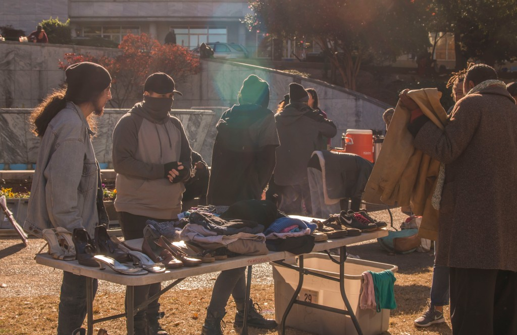 Activists gave away free food and clothing at Hurt Park to protest the police crackdown on food sharing.