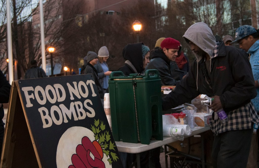 Volunteers for Food Not Bombs Atlanta handed out free food and coffee in front of the Atlanta Municipal Courthouse.